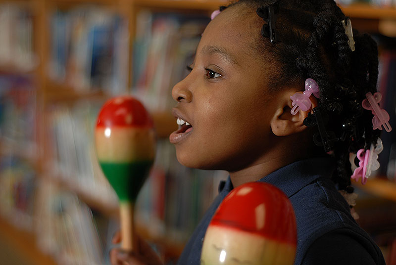 Student playing maracas